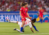 LYON,  - JULY 2: Tobin Heath #17 collides with Demi Stokes #12 during a game between England and USWNT at Stade de Lyon on July 2, 2019 in Lyon, France.
