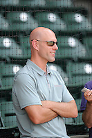 Ben Crockett, director of player development for the Boston Red Sox, watches Yoan Moncada of the Greenville Drive (not pictured) take batting practice before a game against the Lexington Legends on Monday, May 18, 2015, at Fluor Field at the West End in Greenville, South Carolina. Moncada, a 19-year-old prospect from Cuba, made his professional debut today in the Red Sox organization. (Tom Priddy/Four Seam Images)