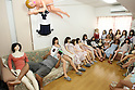 July 5, 2010 - Tokyo Japan - Ta-bo, an avid Love Doll collector, reads while surrounded by his collection of Love Dolls in Tokyo, Japan, on July 5, 2010. The 50-year-old Japanese engineer who rents a special three-bedroom apartment for his Love Dolls, says he owns more than one hundred, which is, to his mind, the world's largest collection of its kind.