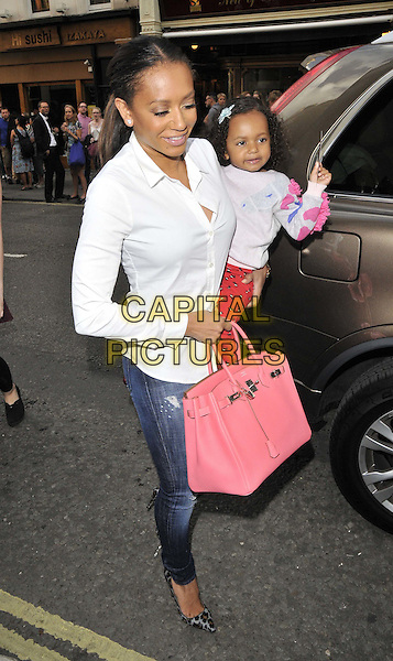 LONDON, ENGLAND - JUNE 25: Melanie Brown ( Mel B ) &amp; her daughter attend the &quot;Charlie &amp; the Chocolate Factory&quot; media night performance, Theatre Royal Drury Lane, Catherine St., on Wednesday June 25, 2014 in London, England, UK.<br /> CAP/CAN<br /> &copy;Can Nguyen/Capital Pictures