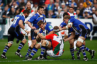Photo: Richard Lane/Richard Lane Photography. Bath Rugby v Biarritz Olympique. Heineken Cup. 10/10/2010. Bath's Andy Beattie is tackled by Biarritz' Imanol Harinordoquy.