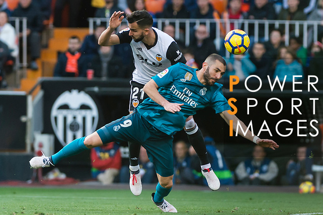 Karim Benzema of Real Madrid (front) fights for the ball with Martin Montoya Torralbo of Valencia CF (back) during the La Liga 2017-18 match between Valencia CF and Real Madrid at Estadio de Mestalla  on 27 January 2018 in Valencia, Spain. Photo by Maria Jose Segovia Carmona / Power Sport Images