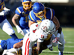 BROOKINGS, SD - NOVEMBER 12:  Michael Frederick #14 from the University of South Dakota is brought down by Christian Rozeboom #2 from South Dakota State University in the first half at the Dana J. Dykhouse Stadium November 12, 2016 in Brookings, South Dakota. (Photo by Dave Eggen/Inertia)