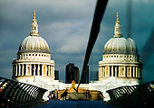 Reflection of St Paul's Cathedral in the glass of the Millennium Foot Bridge, London.
