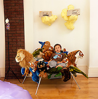 Kenny Schachter's son Fage sits on an animal chair by the Campana Brothers