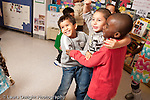 Education preschool 3-4 year olds music time group of children dancing and jumping in response to music horizontal