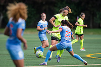 Seattle, WA - Sunday, May 22, 2016: Seattle Reign FC defender Rachel Corsie (4) passes the ball during a regular season National Women's Soccer League (NWSL) match at Memorial Stadium. Chicago Red Stars won 2-1.