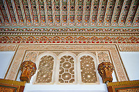 Berber arabesque painted wood ceiling and Morcabe platerwork door surrounds.The Petite Court, Bahia Palace, Marrakesh, Morroco