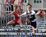 Stephanie Stahl shows her state qualifying form at a track meet at ACC .