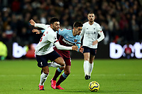 29th January 2020; London Stadium, London, England; English Premier League Football, West Ham United versus Liverpool; Alex Oxlade-Chamberlain of Liverpool competes for the ball with Manuel Lanzini of West Ham United