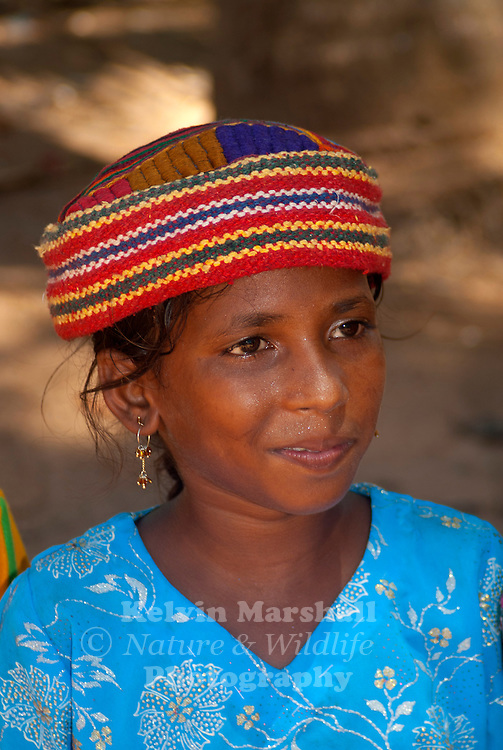Attractive young Rajasthani girl poses for the camera at the markets.