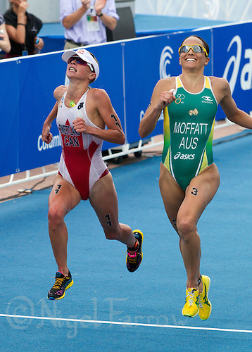 28 JUN 2014 - CHICAGO, USA - Emma Moffatt (AUS) (right) of Australia out sprints Kirsten Sweetland (CAN) (left) of Canada to the finish line during the elite women's ITU 2014 World Triathlon Series round in Grant Park in Chicago in the USA (PHOTO COPYRIGHT © 2014 NIGEL FARROW, ALL RIGHTS RESERVED)