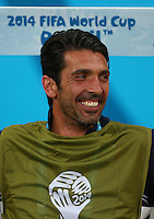 Italy goalkeeper Gianluigi Buffon smiles on the substitutes bench as he misses out through injury