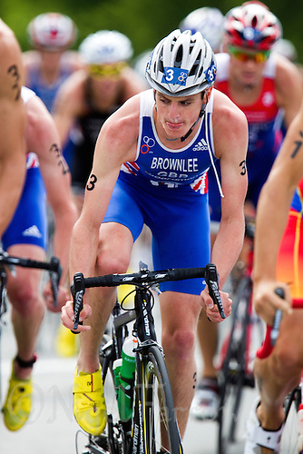 24 JUN 2012 - KITZBUEHEL, AUT - Jonathan Brownlee (GBR) of Great Britain checks the position of competitors around him during the elite men's 2012 World Triathlon Series round at Schwarzsee in Kitzbuehel, Austria (PHOTO (C) 2012 NIGEL FARROW)