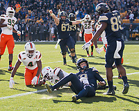 Pitt quarterback Kenny Pickett scores on a 6-yard touchdown run.  The Pitt Panthers upset the undefeated Miami Hurricanes 24-14 on November 24, 2017 at Heinz Field, Pittsburgh, Pennsylvania.
