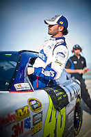 Jimmie Johnson (#48) climbs from his car.