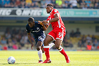 Dru Yearwood of Southend United battles with Chucks Aneke of MK Dons during the Sky Bet League 1 match between Southend United and MK Dons at Roots Hall, Southend, England on 21 April 2018. Photo by Carlton Myrie.