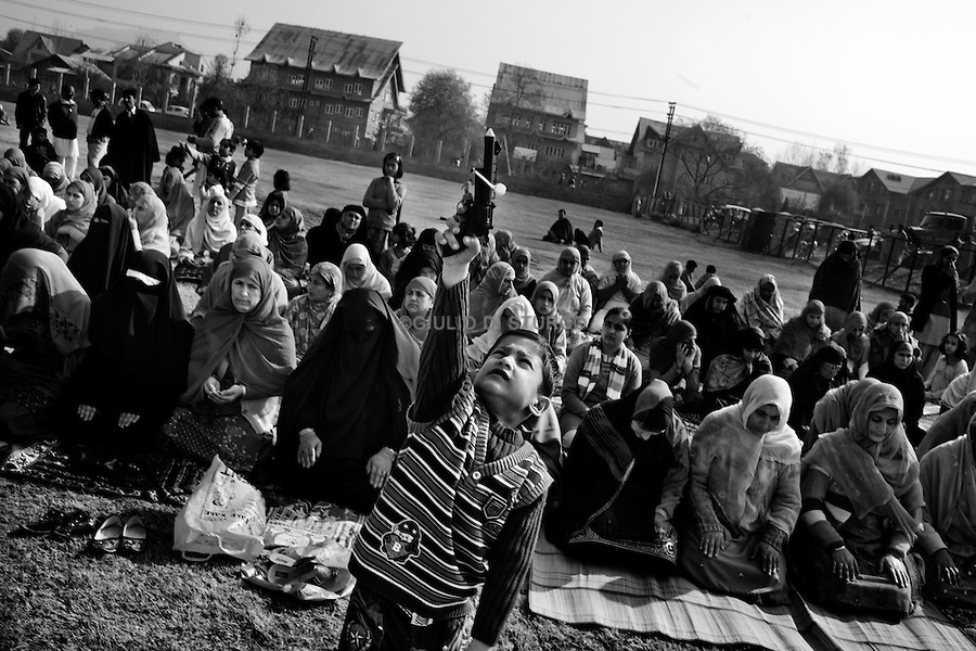People gets together for the Eid Prayer at the  Srinagar Martyr's Graveyard during on 17, November 2010..After the violence in August 2010, the situation in kashmir still uncertain.Political leaders are under House-arrest and the people on the street feels the oppression of the Indian army.Everyone is waiting, and everybody knows Kashmir is going to explode again..