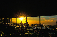 A romantic couple enjoys a glass of wine at sunset  at the Kula Lodge (a 3,000 ft.-elevation) in upcountry Maui.