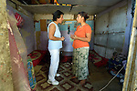 Ljatife Sikovska (left) is director of Ambrela, a grassroots Roma women's organization in Suto Orizari, the Macedonian municipality that is Europe's largest Roma settlement. Here she talks with a woman in her home in Suto Orizari about the woman's lack of sufficient legal documents, a common headache for Roma in Macedonia.