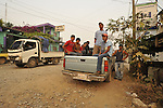 Farmers in pick up trucks and vans at dawn in Ixcan, Guatemala, a dusty border town near Mexico.