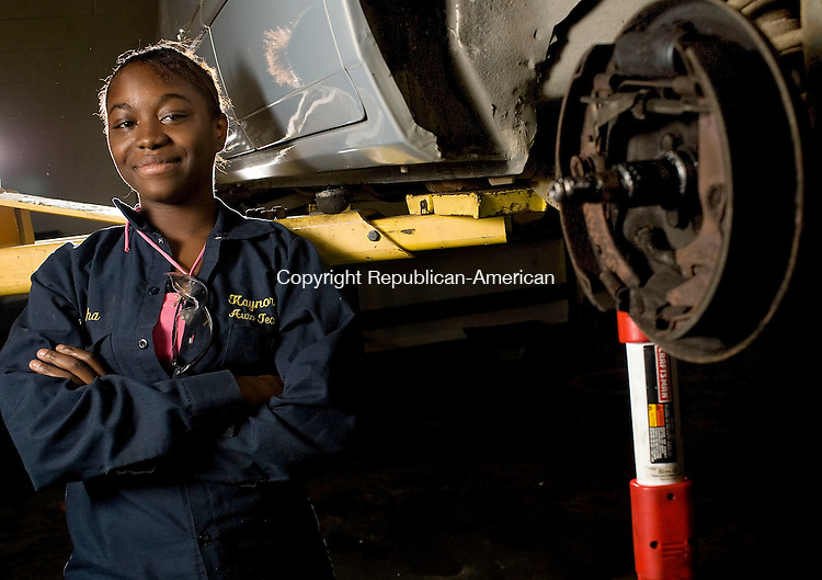 WATERBURY, CT--24 October 07--102407TJ02 - Tanisha Mack, 16, from Naugatuck, stands by a car getting brake work in the automotive technology shop at the W.F. Kaynor Technical High School on Wednesday, October 25, 2007. T.J. Kirkpatrick/Republican-American