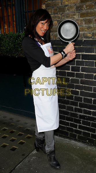 ANNA RYDER RICHARDSON.the Bacon Connoisseurs Week 2009 launch and photocall, The Bleeding Heart restaurant, London, England, UK, March 16th 2009..full length white apron frying pan funny saucepan .CAP/CAN.©Can Nguyen/Capital Pictures