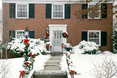 Brick house decorated for Christmas with bows and wreaths