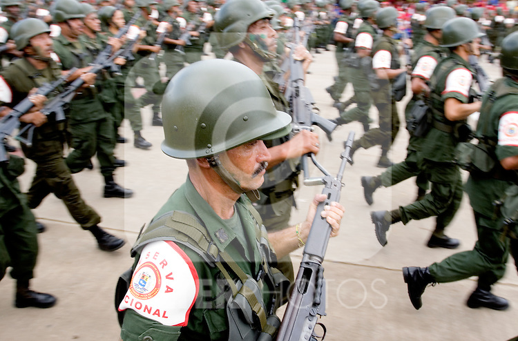 "Venezuelan reserve troops march during a military parade in Valencia, Venezuela, on Saturday, June 24, 2006. The military parade was to celebrate Army Day and took place in ""Campo de Carabobo"", the field where the last big battle for the Venezuelan independence was won. (ALTERPHOTOS/Alvaro Hernandez)."
