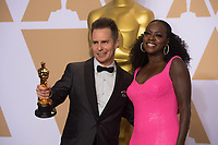 Viola Davis (right) and Sam Rockwell pose backstage with the Oscar&reg; for performance by an actor in a supporting role, for work on &ldquo;Three Billboards Outside Ebbing, Missouri&rdquo; during the live ABC Telecast of The 90th Oscars&reg; at the Dolby&reg; Theatre in Hollywood, CA on Sunday, March 4, 2018.<br /> *Editorial Use Only*<br /> CAP/PLF/AMPAS<br /> Supplied by Capital Pictures