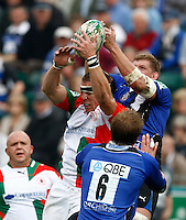 Photo: Richard Lane/Richard Lane Photography. Bath Rugby v Biarritz Olympique. Heineken Cup. 10/10/2010. Biarritz' Imanol Harinordoquy and Bath's Stuart Hooper challenge for a lineout.
