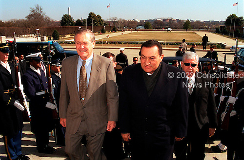 Washington, DC - March 5, 2002 -- President Hosni Mubarak of Egypt (right) is escorted into the Pentagon by United States Secretary of Defense Donald H. Rumsfeld (left) on March 5, 2002.  Mubarak and Rumsfeld will meet to discuss the war on terrorism, the Israeli-Palestinian conflict and other regional security issues.    .Mandatory Credit: Robert D. Ward / DoD via CNP