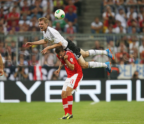 06.09.2013. Allianz Arena, Munich, Germany.  Per Mertesacker ger climbs against Martin Harnik AUT Germany versus Austria  World Cup Qualification Munich