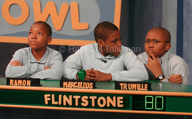 BowlGR011807aRGB/Raphael Talisman/The Gazette/011707. Flinstone Elementary School Science Bowl team mates (from left) Ramon Beam, 11, Marcellus Hunter, 12, and Trumille Hines, 11, all of Oxin Hill and in 6th grade, ponder a question during their Science Bowl match-up against Francis Scott Key Elementary School on Wednesday afternoon.