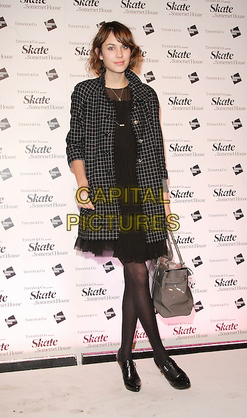 ALEXA CHUNG.At Somerset House Ice Rink VIP Launch Party, London, England, November 20th 2007..full length black and white checked coat dress tights ankle shoe boots grey patent bag.CAP/ROS.©Steve Ross/Capital Pictures
