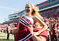 NWA Democrat-Gazette/CHARLIE KAIJO Ann Cliarecook and Timmy Faubus practice a throw ahead of the first half of the game between Arkansas Razorbacks and New Mexico State Aggies on Saturday, September 30, 2017 at Razorback Stadium in Fayetteville.