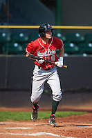 Great Lakes Loons outfielder Logan Landon (9) bunts during a game against the Clinton LumberKings on August 16, 2015 at Ashford University Field in Clinton, Iowa.  Great Lakes defeated Clinton 3-2 in ten innings.  (Mike Janes/Four Seam Images)