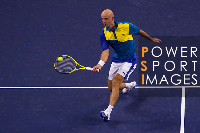 SHANGHAI, CHINA - OCTOBER 12:   Ivan Ljubicic of Croatia returns a ball to Ze Zhang of China during day two of the 2010 Shanghai Rolex Masters at the Shanghai Qi Zhong Tennis Center on October 12, 2010 in Shanghai, China.  (Photo by Victor Fraile/The Power of Sport Images) *** Local Caption *** Ivan Ljubicic
