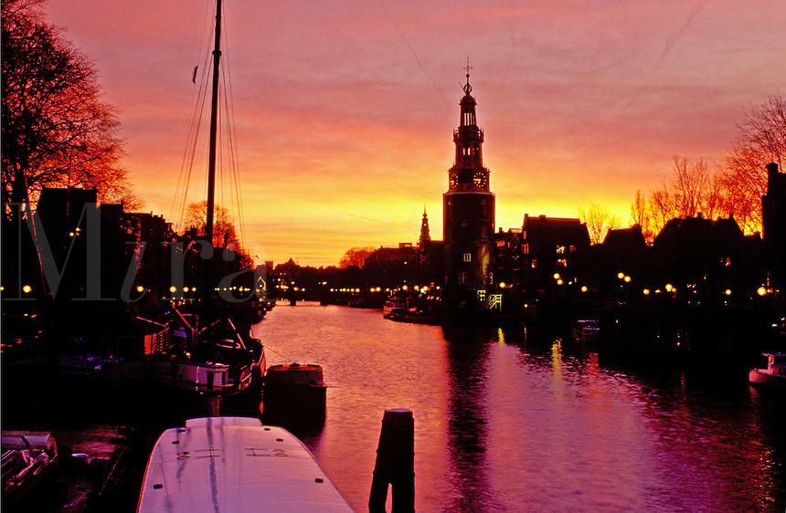 canal, Amsterdam, The Netherlands, Holland, Europe, Scenic view of a canal (grachten) at sunset in downtown Amsterdam.