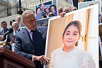 United States Senate Minority Leader Chuck Schumer (Democrat of New York) holds a photo of New York resident Emilie Saltzman, who suffered a traumatic brain injury, during a press conference on Capitol Hill in Washington D.C., U.S. to discuss health care coverage for those with pre-existing conditions on July 9, 2019.<br /> CAP/MPI/RS<br /> ©RS/MPI/Capital Pictures