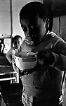 Child of poor Montgomery Ala family eating breakfast. Copyright Jim Peppler/1967. This and over 10,000 other images are part of the Jim Peppler Collection at The Alabama Department of Archives and History:  http://digital.archives.alabama.gov/cdm4/peppler.php