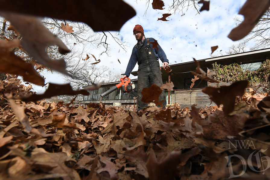 NWA Democrat-Gazette/J.T. WAMPLER Patrick Buckley of Fayetteville blows leaves Thursday Jan. 10, 2019 at a home in Fayetteville. Buckley is a handyman and does landscaping, cabinetry and stone masonry work.