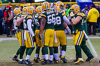 Green Bay Packers defensive players huddle up prior to a game against the New York Giants on January 8th, 2017 at Lambeau Field in Green Bay, Wisconsin.  Green Bay defeated New York 38-13. (Brad Krause/Krause Sports Photography)