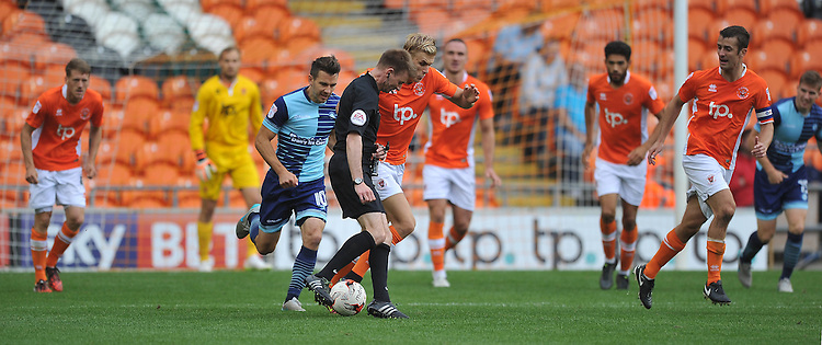 Referee Ollie Yates impedes the progress of Blackpool's Brad Potts<br /> <br /> Photographer Bethany Hankey/CameraSport<br /> <br /> Football - The EFL Sky Bet League Two - Blackpool v Wycombe Wanderers - Saturday 20 August 2016 - Bloomfield Road - Blackpool<br /> <br /> World Copyright &copy; 2016 CameraSport. All rights reserved. 43 Linden Ave. Countesthorpe. Leicester. England. LE8 5PG - Tel: +44 (0) 116 277 4147 - admin@camerasport.com - www.camerasport.com