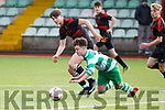 Brendans Park's Shane Jordan and Killarney Celtic's Lee Downing, all eyes on the ball during their encounter in the Kerry Youth Cup final in Mounthawk Park, Tralee on Saturday last.