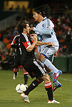 10 March 2012: DC's Dejan Jakovic (CRO) (left) and Kansas City's Roger Espinoza (HON) (right) collide. Sporting Kansas City defeated DC United 1-0 at RFK Stadium in Washington, DC in a 2012 regular season Major League Soccer game.