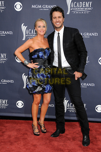 GUEST & LUKE BRYAN .46th Annual Academy of Country Music Awards - Arrivals held at the MGM Grand Garden Arena, Las Vegas, Nevada, USA, 3rd April 2011..full length black blue dress strapless hand on hip suit tie print  jeans jacket .CAP/ADM/BP.©Byron Purvis/AdMedia/Capital Pictures.