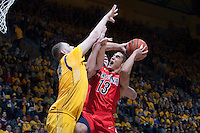 Kameron Rooks of California tries to block the shot from Nick Johnson of Arizona during the game at Haas Pavilion in Berkeley, California on February 1st, 2014.  California Golden Bears defeated Arizona Wildcats, 60-58.