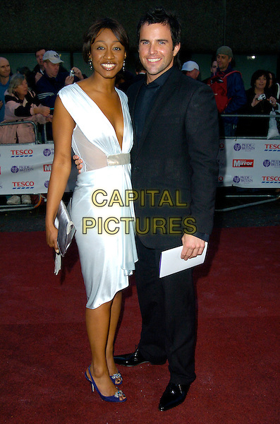 BEVERLEY KNIGHT & GUEST.Arrives at The Pride Of Britain Awards,.The London Studios, London, SE1, England,.October 9th 2007..full length black suit white dress beverly.CAP/CAN.©Can Nguyen/Capital Pictures