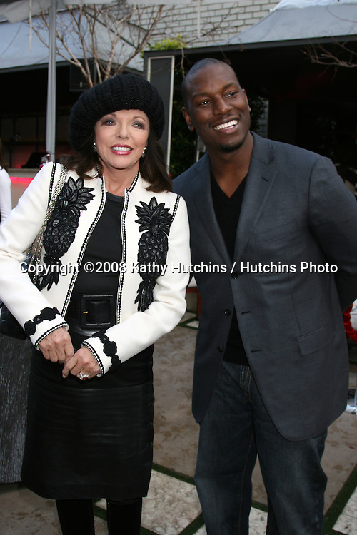 Joan Collins & Tyson Beckford.GBK Productions Oscar Gifting Suite.Boulevard3.Los Angeles, CA.February 22, 2008.©2008 Kathy Hutchins / Hutchins Photo....